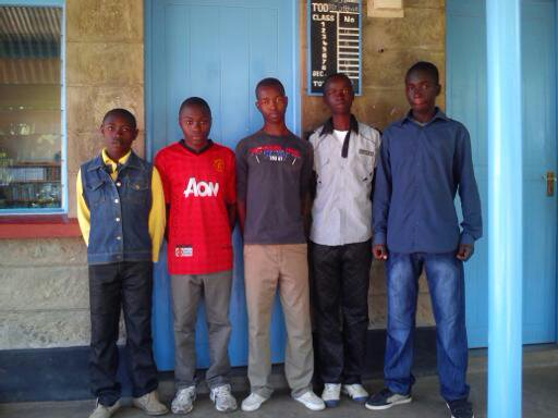 Five african boys in coloured background blue doors