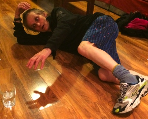 Miki lying on floor feeling sore after training for marathon