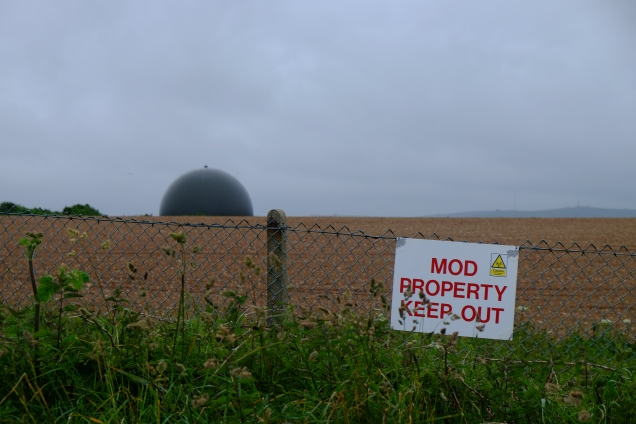 Brown Dome in brown field fence and MOD notice