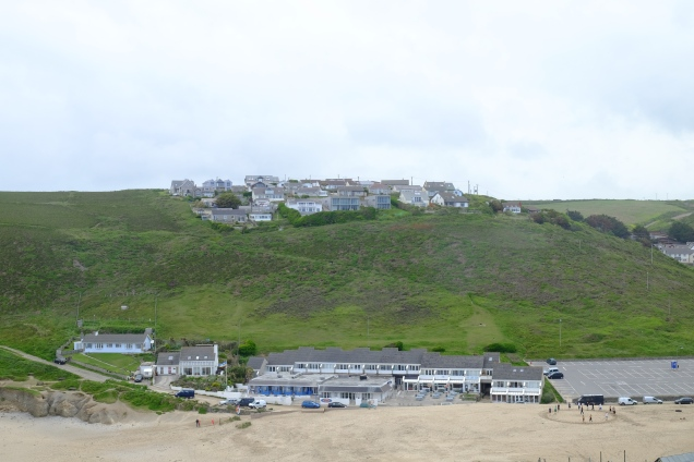 Houses, green hill, sand, sky