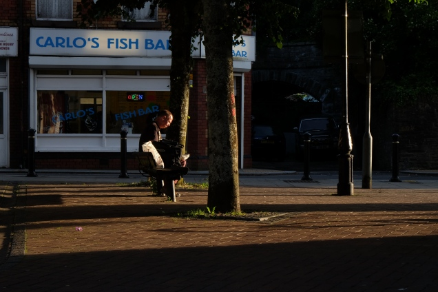 Man on bench, Carlos Fish Bar