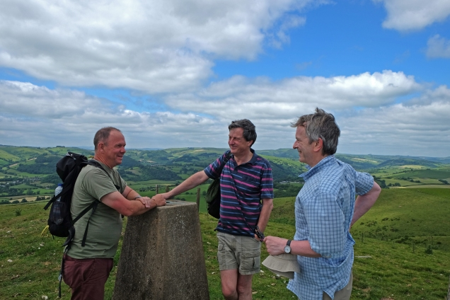 Three men and trig point