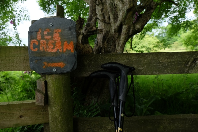 Orange ice cream sign painted on slate and nailed to fence on Offa's Dyke