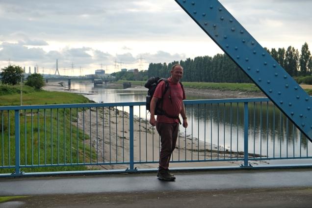 Man on Queensferry Bridge view west over River Dee