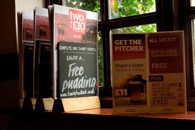 Notice advertising free pudding
