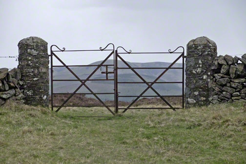 Gate at Dead Wife's Grave with view of hills beyond